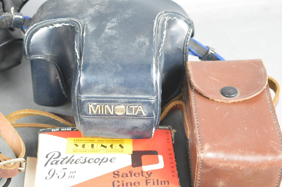A group of vintage cameras, lens and some accessories to include, Minolta 7000 and Sigma 70mm- - Image 2 of 2