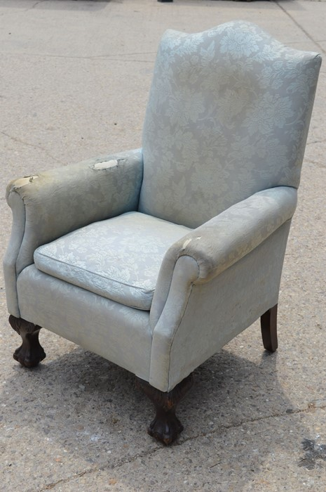 A Georgian style armchair with ball and claw feet with light blue upholstery