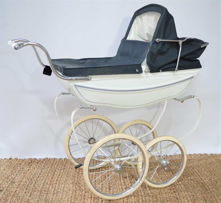 A vintage white and navy Silver-Cross coach built dolls pram