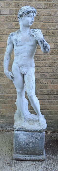 A Classical style garden statue on plinth, male figure. 164cms