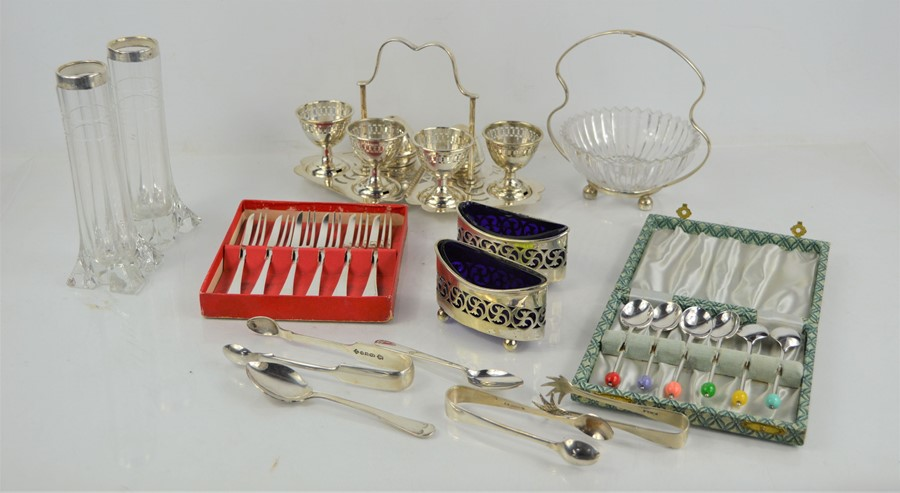 A quantity of silver plate to include a egg cup set on stand, pair of bud vases with silver rims,