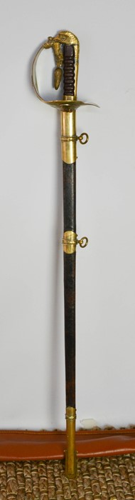 An RAF dress sword with brass hilt, complete with dust sheet, and leather scabbard, with applied RAF
