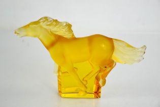 A Rene Lalique Kazak glass amber horse, etched Lalique. 11.5cms x 18cms