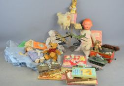 A group of vintage toys and books to include Dinky, Beatrix Potter stick puppet, dolls etc