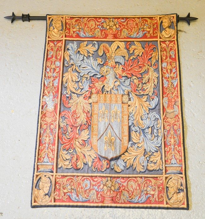 A tapestry French style wall hanging, on metal pole, depicting a crest, with shield surmounted by