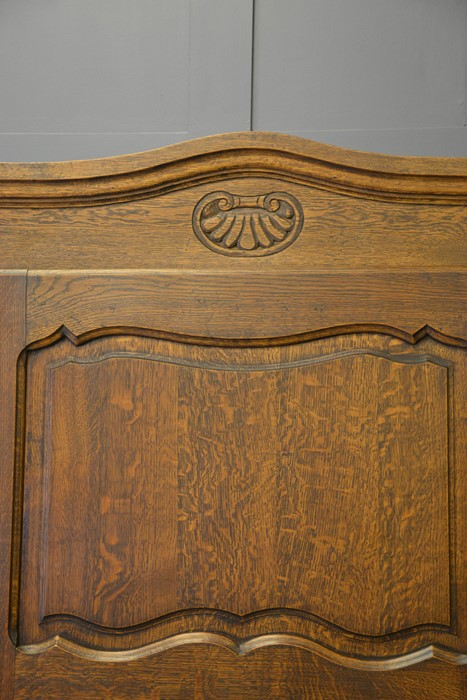 A French single door oak armoire, with shaped and carved top, above a panelled door, enclosing - Image 2 of 2