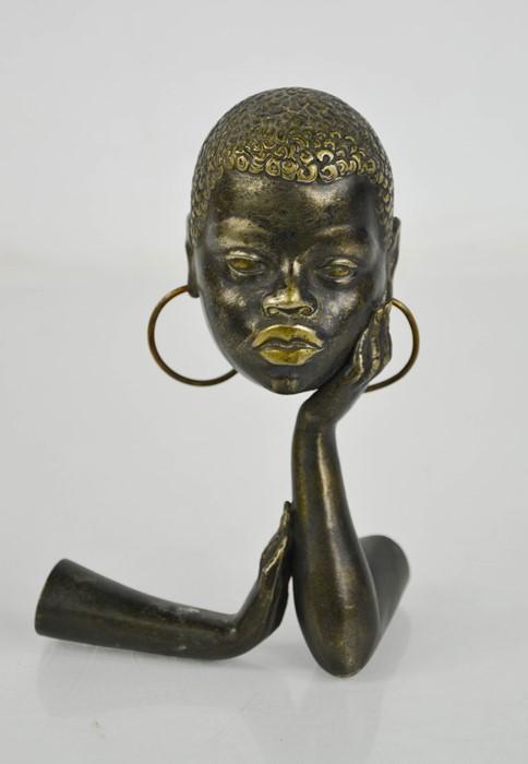 A Studio Art Deco period metal work sculpture, circa 1930, African lady with hoop earrings,