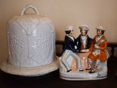 A Victorian Staffordshire figure group, tavern scene with three men, 21cm high together with a