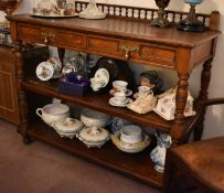 A oak 19th century buffet, three tiers, the upper tier having galleried back and two drawers with
