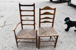 A 19th century elm ladder back armchair and a hall chair, both with rush seats