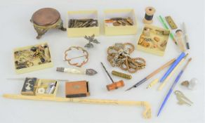 A group of collectibles to include pen nibs, bone handled pencil, white metal watch chain and