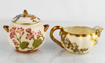 A ROyal Worcester gilded ivory ground jug, painted with flowers, date code 1888, 3 ins high,