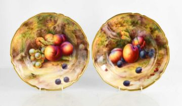 A fine pair of Royal Worcester bowls by Horace Price, painted with peaches and grapes, puce mark