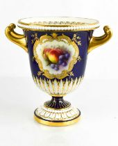 A Royal Worcester campana pedestal vase, painted by R Seabright with a deep blue ground, with twin