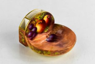 A Royal Worcester porcelain matchbox holder, painted with fruit and signed Ayrton, with Strike board