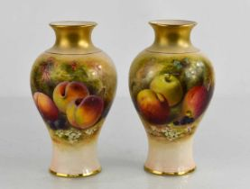 A pair of Royal Worcester vases by Rickets, painted with apples and peaches on a mossy ground,