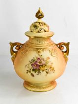 A Royal Worcester blush ivory vase, and cover with painted floral decoration and pierced and