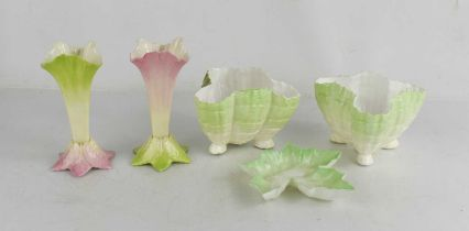 A pair of Royal Worcester spill vases, in green and pink tint with leaf form feet, together with a