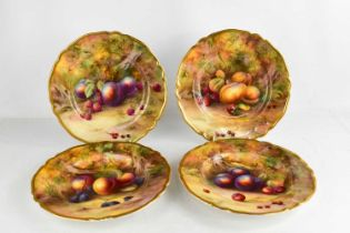 A set of four Royal Worcester plated by Horice Price, painted with fruit on a mossy ground, circa