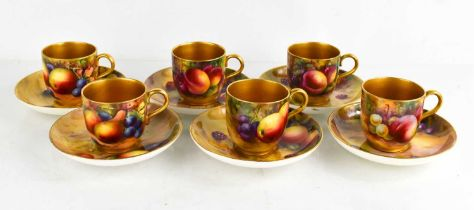 A set of six Royal Worcester cups and saucers, painted with fruit on mossy ground, by Everett,