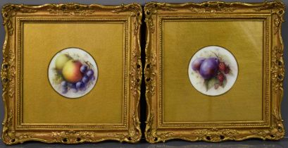 A pair of Royal Worcester porcelain plaques, by R. Seabright, both depicting fruit, 4 ins