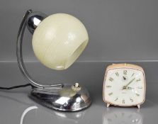 A Retro chrome table lamp with glass shade, together with a vintage Smiths alarm clock.