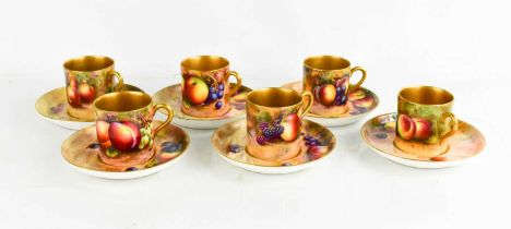 A set of six Royal Worcester coffee cans and saucers, painted with fruit on mossy ground, by