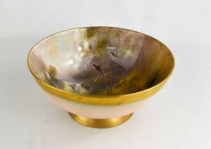 A Royal Worcester bowl, by JAS Stinton, painted with five pheasants, in a wooded landscape, date