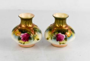 A pair of Royal Worcester vases painted with roses, circa 1900, 4ins high.