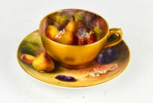 A Royal Worcester miniature cup and saucer, the cup painted with fruit by H. Martin, the saucer by
