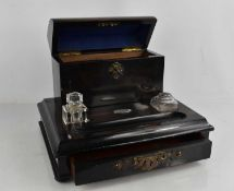 A 19th century coromandel stationary stand, with inkwell, the domed lid with key and drawer below,