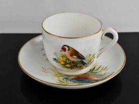A Royal Worcester tea cup and saucer, by Powell, the cup painted with a Goldfinch, the saucer with a