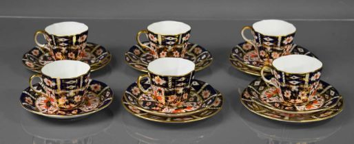 A set of six Royal Crown Derby Imari pattern cups and saucers, together with five cake plates, no