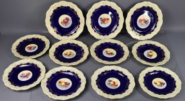 A set of twelve Royal Worcester plates, stamped underside Fide et Fiducia, each hand painted with
