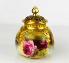 A Royal Worcester vase and cover, painted to the body with roses, and having a pierced cover,