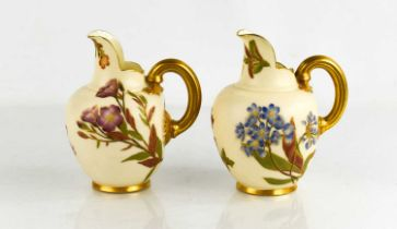 Two Royal Worcester flat back jugs, blush ground, painted with flowers, date code for 1888, 1890,