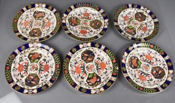 Twelve Royal Crown Derby plates, six 26cm diameter, six 22cm diameter, in the old imari pattern,