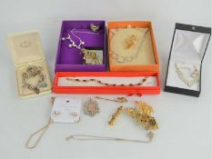 A silver charm bracelet with various charms, silver fob, together with a group of costume jewellery