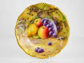 A Royal Worcester plate painted with fruit on a mossy ground, by Lockyer, circa 1930, signed, 26cm