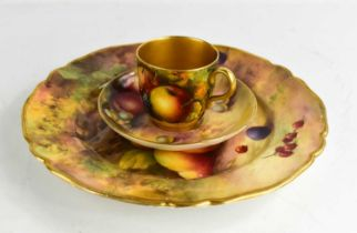 A Royal Worcester trio painted with fruit, by H. Price, Stanley and Townsend, the plate 9ins