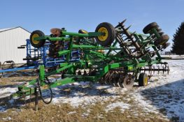 9-shank John Deere 512 disc ripper, wing wheels, hyd fold, front & rear disc, single point depth
