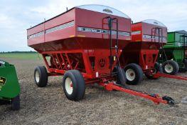 Unverferth 530 gravity bed wagon, 425/65 R 22.5 tires, hyd surge brakes, lights, roll tarp
