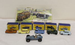 Collection of vintage toys to include five vintage Matchbox vehicles, with original boxes and an