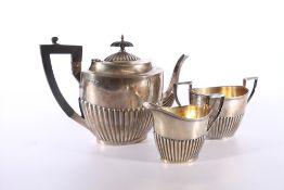George V silver three piece tea set of half gardooned design by Walker and Hall, Sheffield 1913