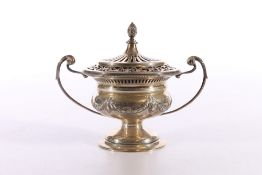Edwardian Art Nouveau period silver urn and cover decorated in the Adams style with garlands,