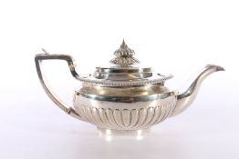 George IV silver tea pot with half gadrooned design, maker marks IW possibly forJohn Wakefield,