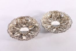 Pair of Edwardian silver dishes with flowerhead pattern centre and pierced rims by Walker and Hall