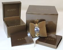 "Gucci ""Marina Chain"" lady's stainless steel wristwatch, the rectangular black dial in oval bezel"