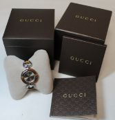 Gucci lady's bamboo and stainless steel wristwatch with bronzed circular dial and snaffle bit