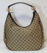 "Gucci ""Hobo"" lady's handbag in beige and brown GG canvas with leather trim and handle and gold toned"